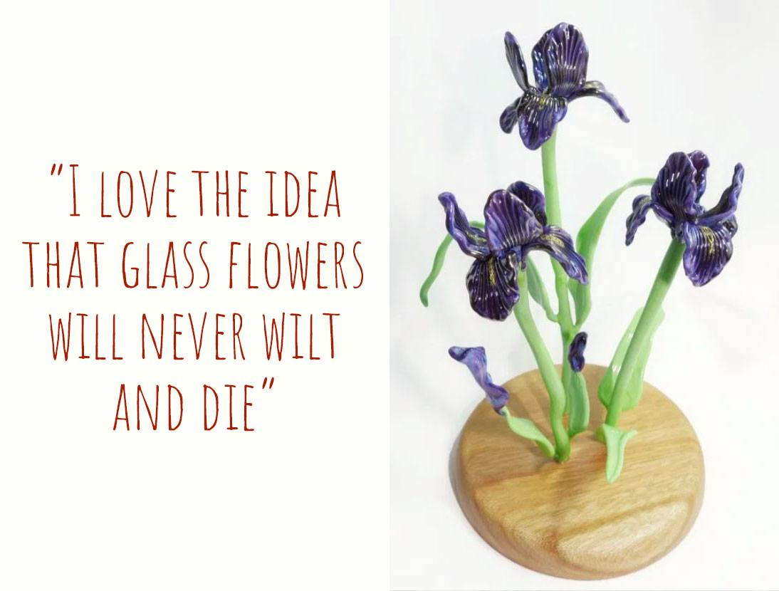 A glass sculpture of purple irises in a wooden stand: 'I love the idea that glass flowers will never wilt and die'