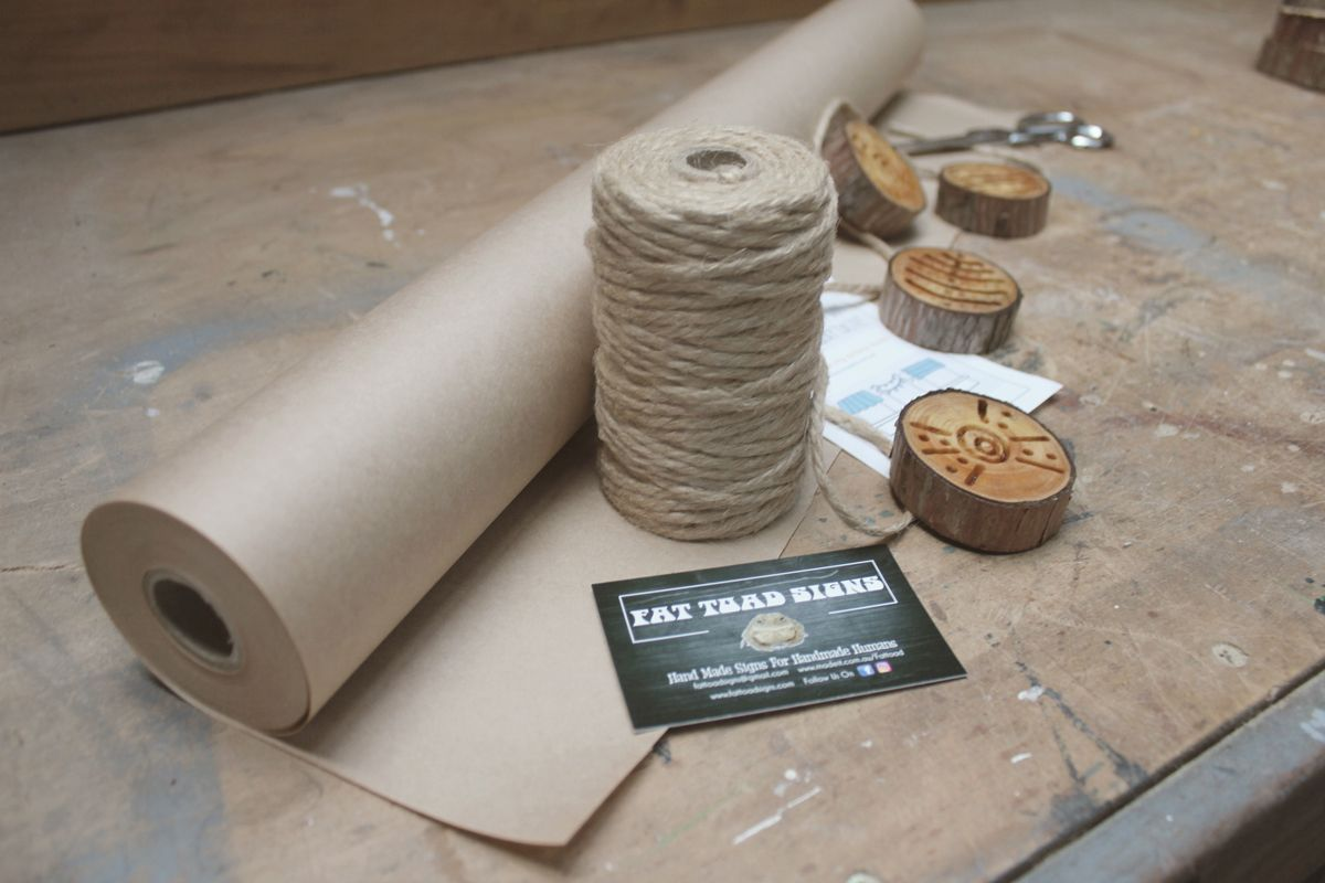 Packaging in Progress: All Fat Toad Signs come wrapped in brown paper and tied with string