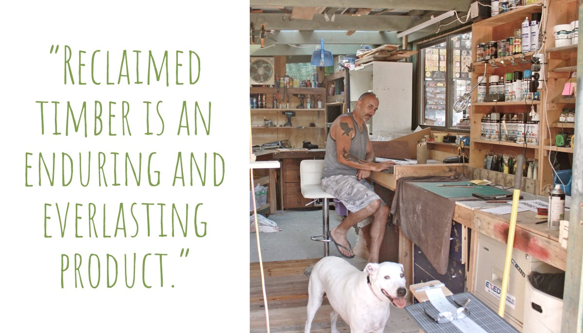 Clint in his workshop with four-legged supervisor, Bonnie: 'Reclaimed timber is an enduring and everlasting product'