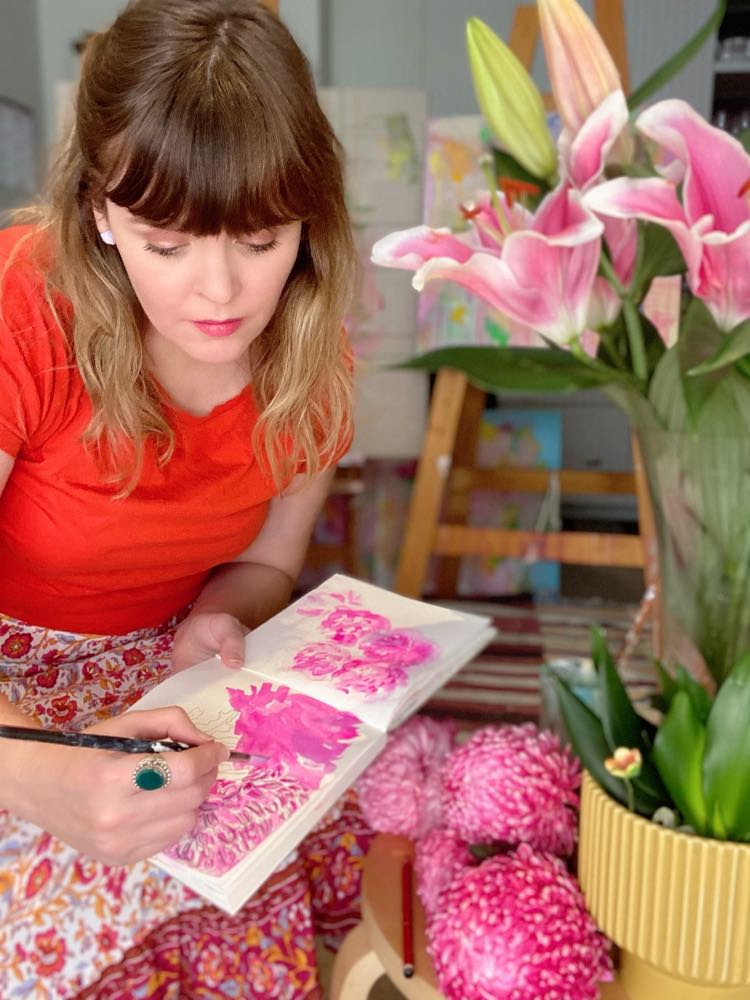 Natasha at work on a botanical painting in her home studio