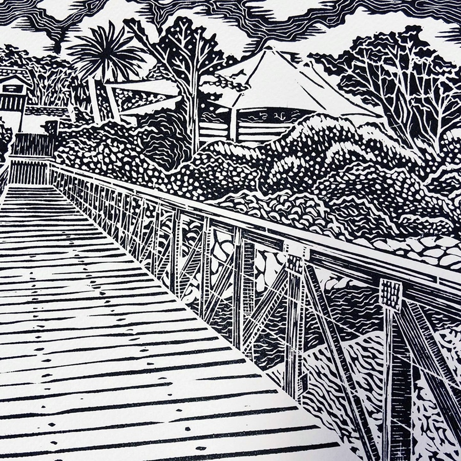 A deviation from Sarah's animal prints, a lino print of a foot bridge leading to 'Lord Somers Camp'