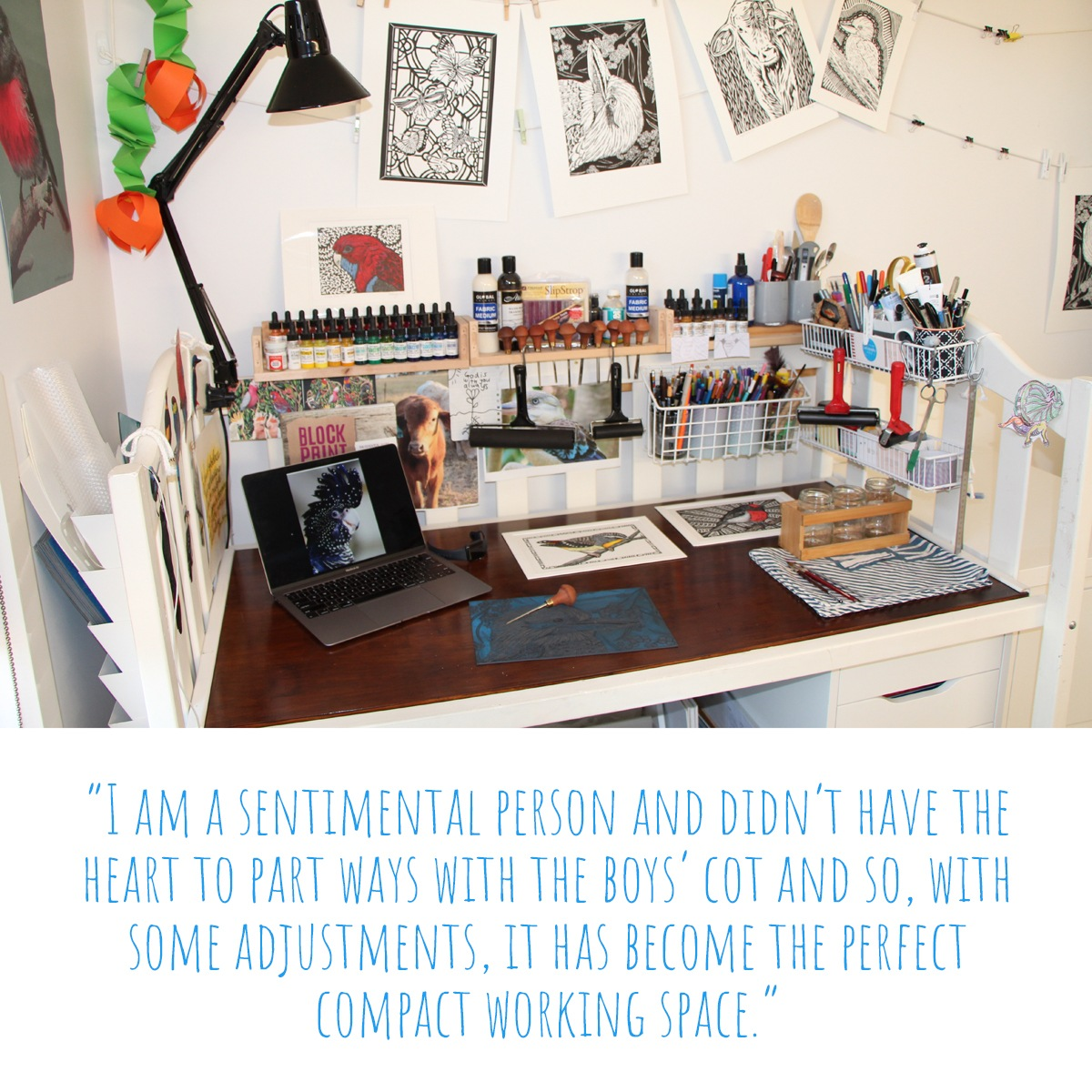 The converted cot that now serves as Sarah's work desk and a collection of prints hung from string to dry on the wall behind; 'I am a sentimental person and didn't have the heart to part ways with the boys' cot and so, with some adjustments, it has become the perfect compact working space'