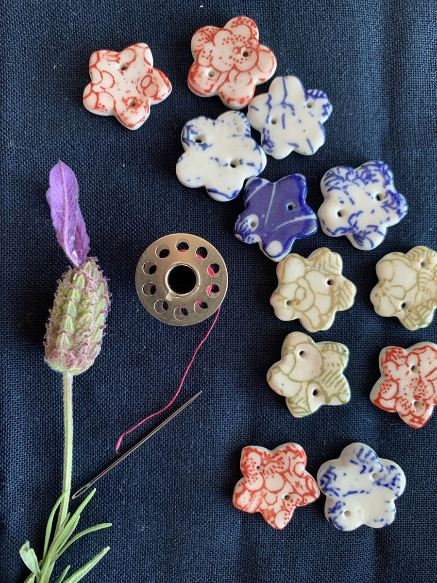 An assortment of patterned porcelain flower-shaped buttons by The Intrepid Potter'