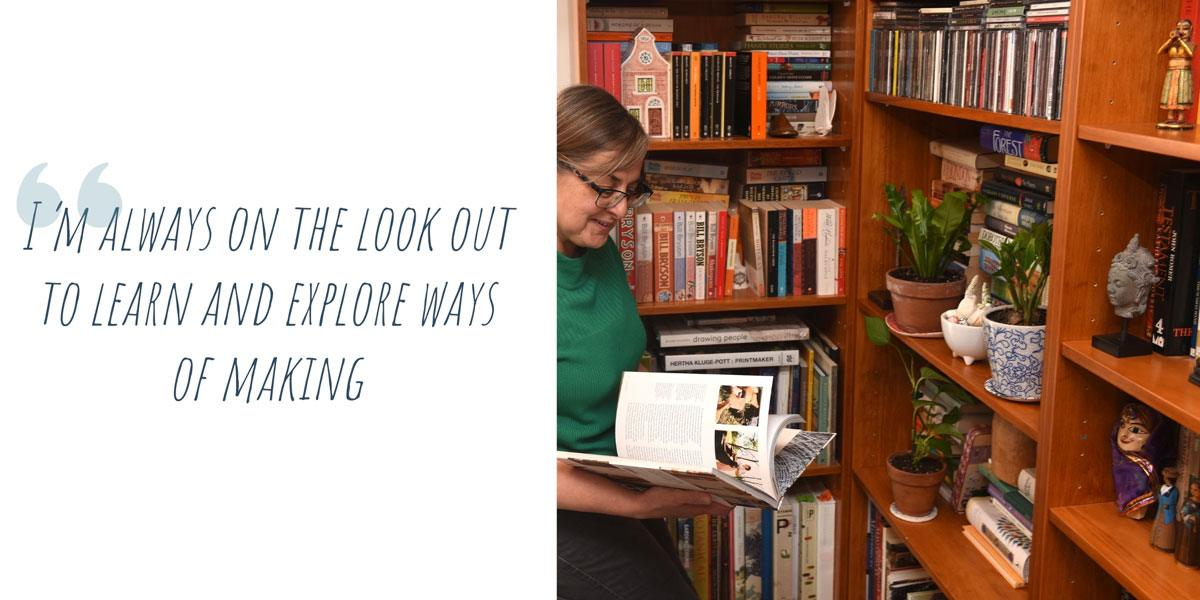 Teresa reading in a bookshelf-lined corner of her home; 'I'm always on the lookout to learn and explore ways of making'