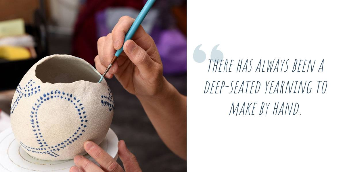 Teresa hand-painting underglaze designs onto a porcelain pot; 'There has always been a deep-seated yearning to make by hand'