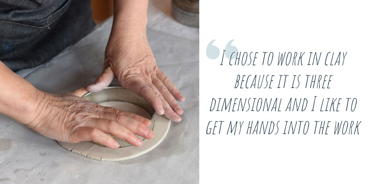 Teresa's hands pressing a cutting ring into a flattened disc of porcelain clay; 'I chose to work in clay because it is three dimensional and I like to get my hands into the work'