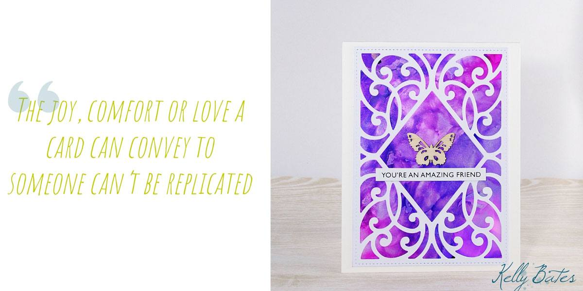 A bright pink and purple friendship card with filigree detail and wooden butterfly embellishment; 'The joy, comfort or love a card can convey to someone can't be replicated'
