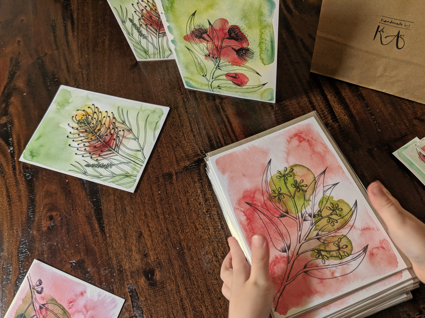 A stack of Kirby's hand-drawn cards featuring native plants