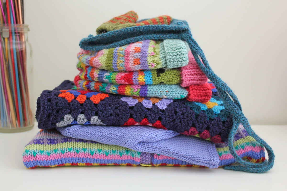 A stack of colourful children's knits from Krazy Knits by Karen