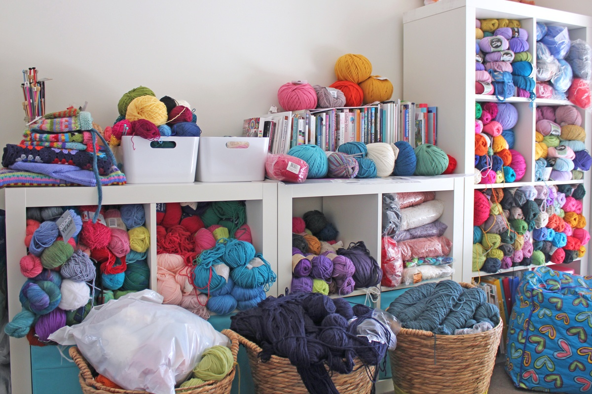 Karen's ever expanding stash of colourful yarns and craft books overflows from shelves into large baskets