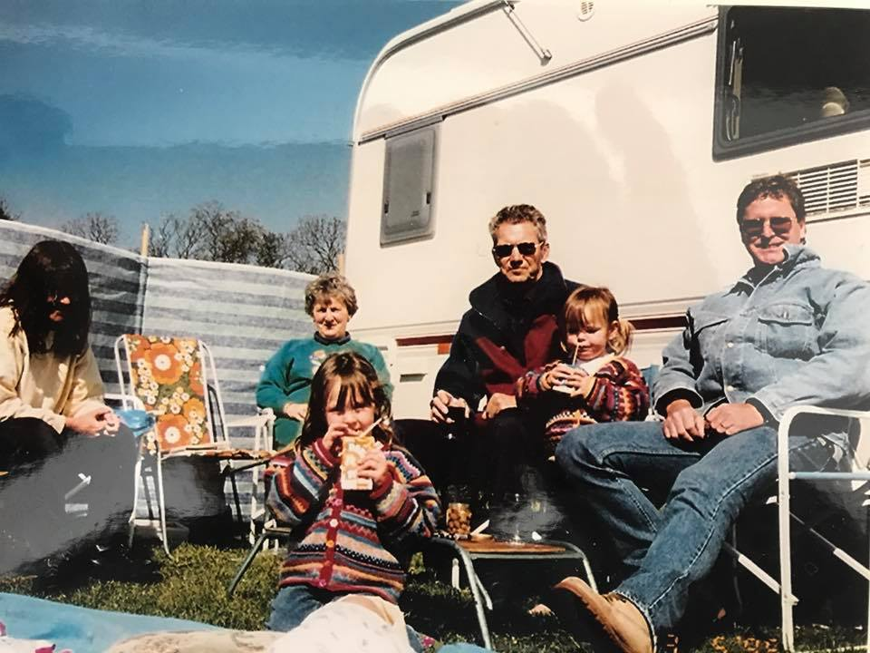 Karen's first colourful cardigans sported by her daughters with the rest of the family in front of their caravan in 1994