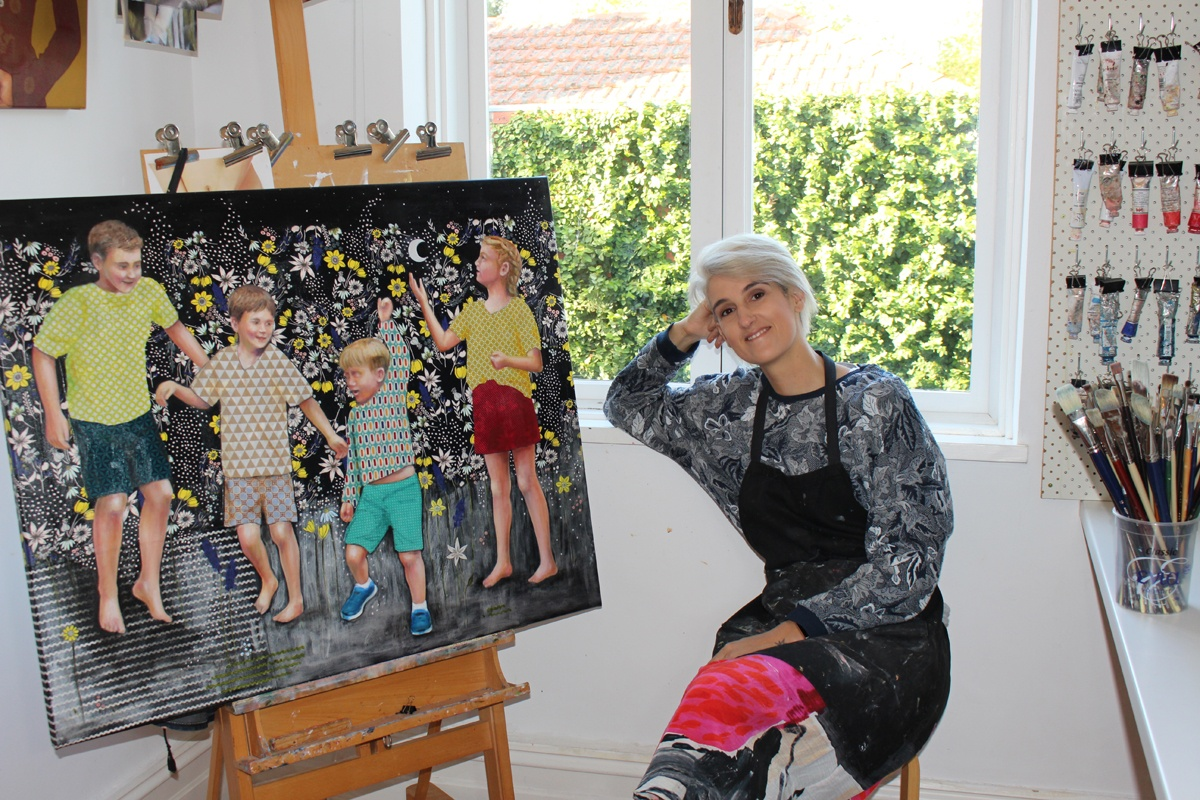 Leah Mariani in her home studio with a large work in progress