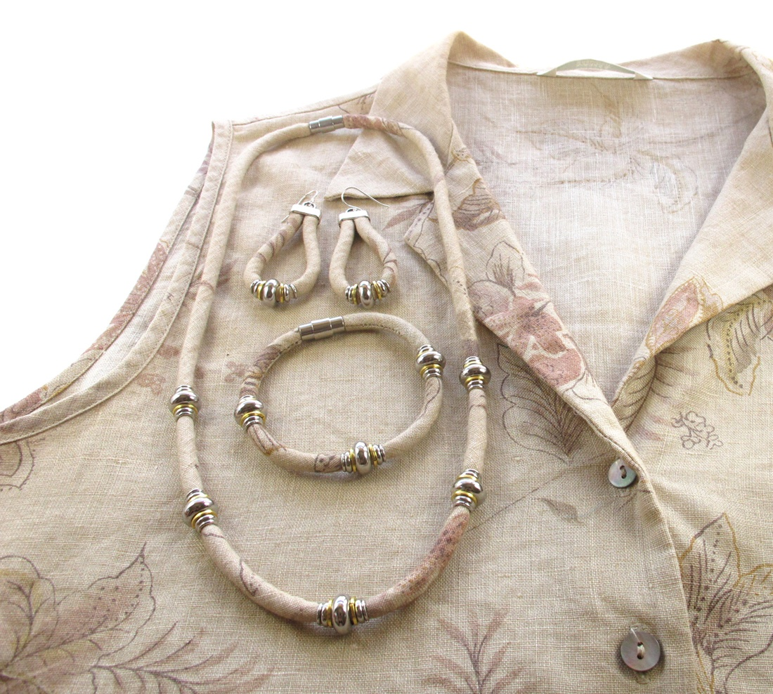Upcycled linen necklace, earrings and bracelet against the blouse they were upcycled from