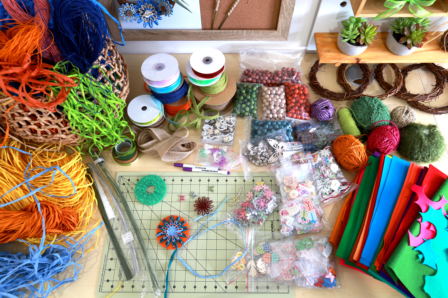 Some of Marketa's making materials; colourful fibres, ribbons, buttons, felts, beads, twine, wire, embelishments and tiny round looms