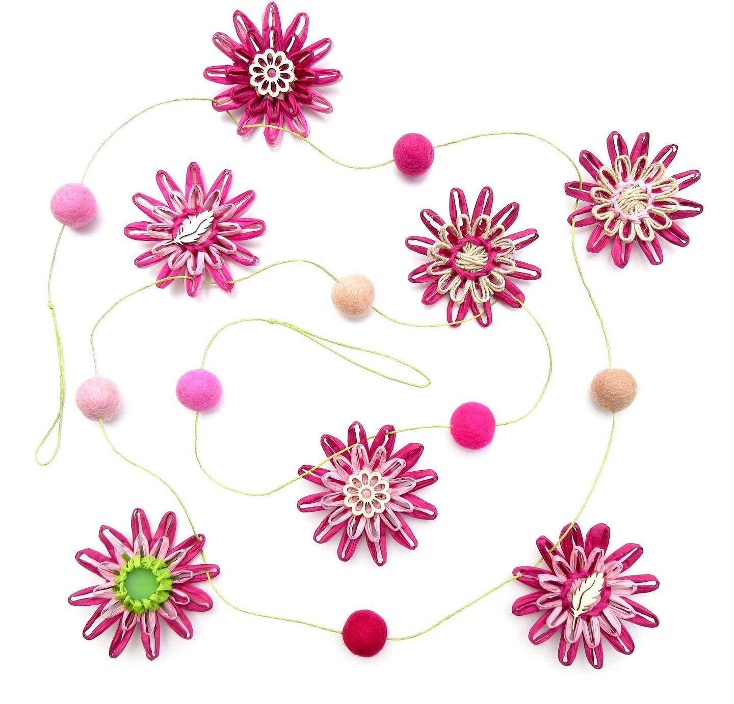 A raffia flower and pom-pom garland in happy shades of pink and a dash of lime green by M Decor Botanica