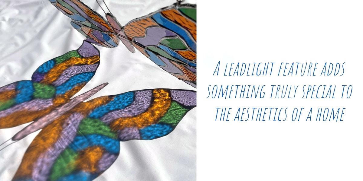 The completes butterfly design catching the sunlight an projecting a colourful reflection; 'A leadlight feature adds something truly special to the aesthetics of a home'