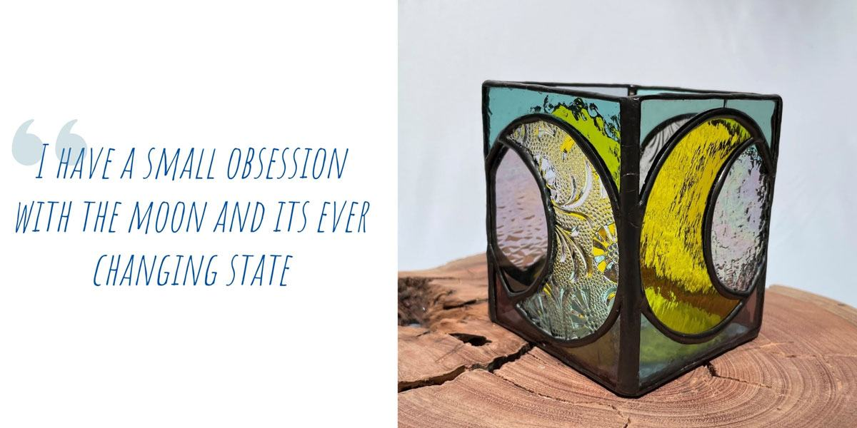 Kahlea's 'Moonlight' stained glass candle holder on a block of raw timber; 'I have a small obsession with the moon and its ever-changing state'