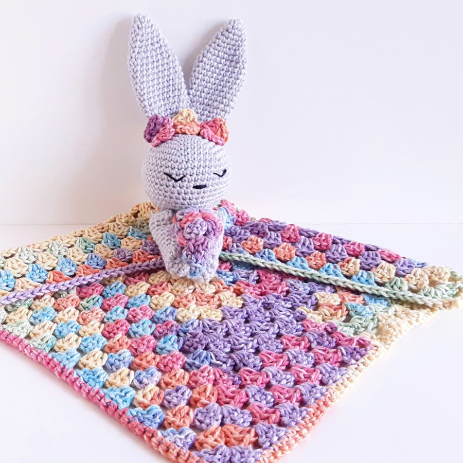 A beautiful crochet rainbo bunny blanket baby toy handmade by Noodles Crochet in Western Australia