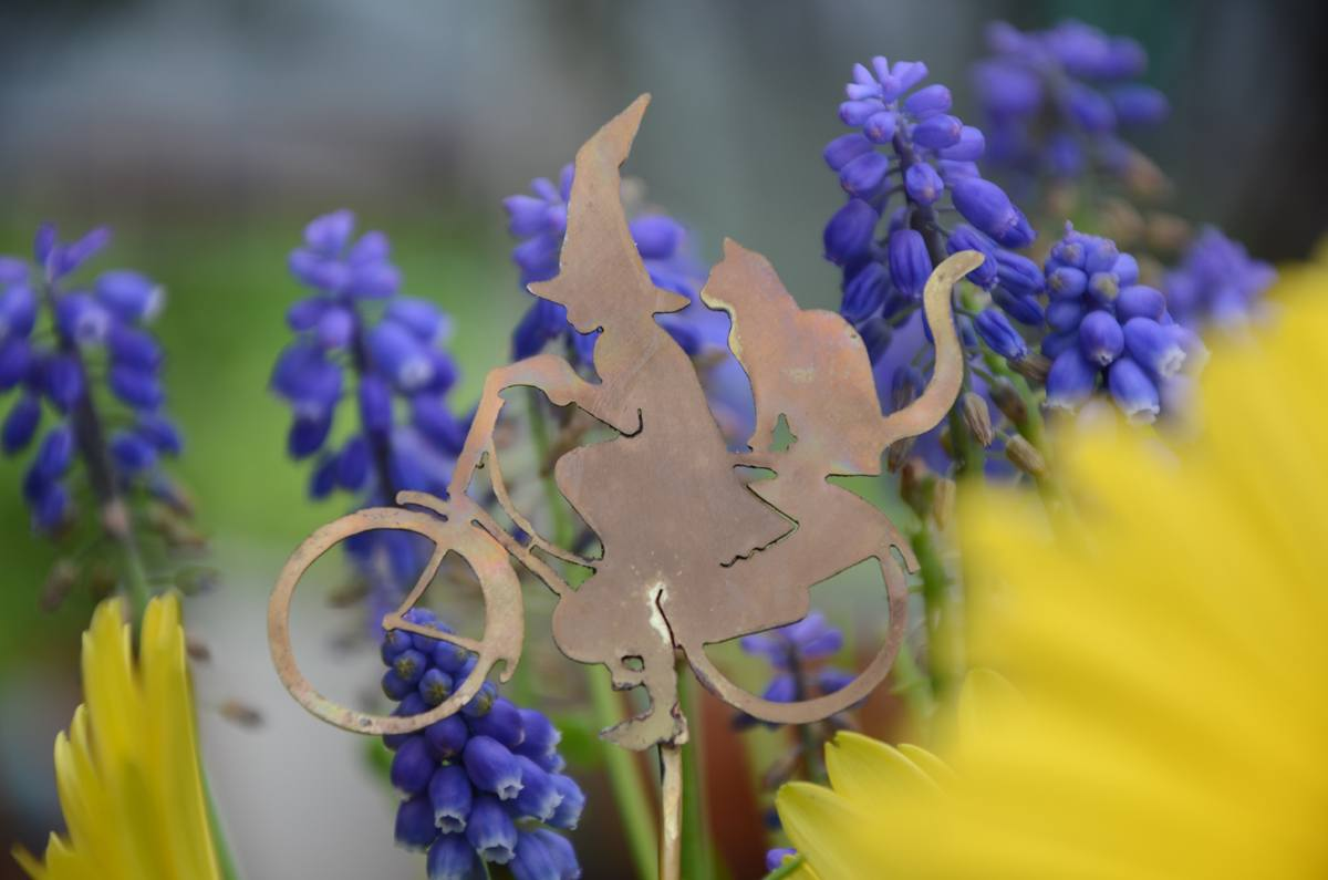 Witch and cat on a bycicle: hand-crafted copper garden ornament