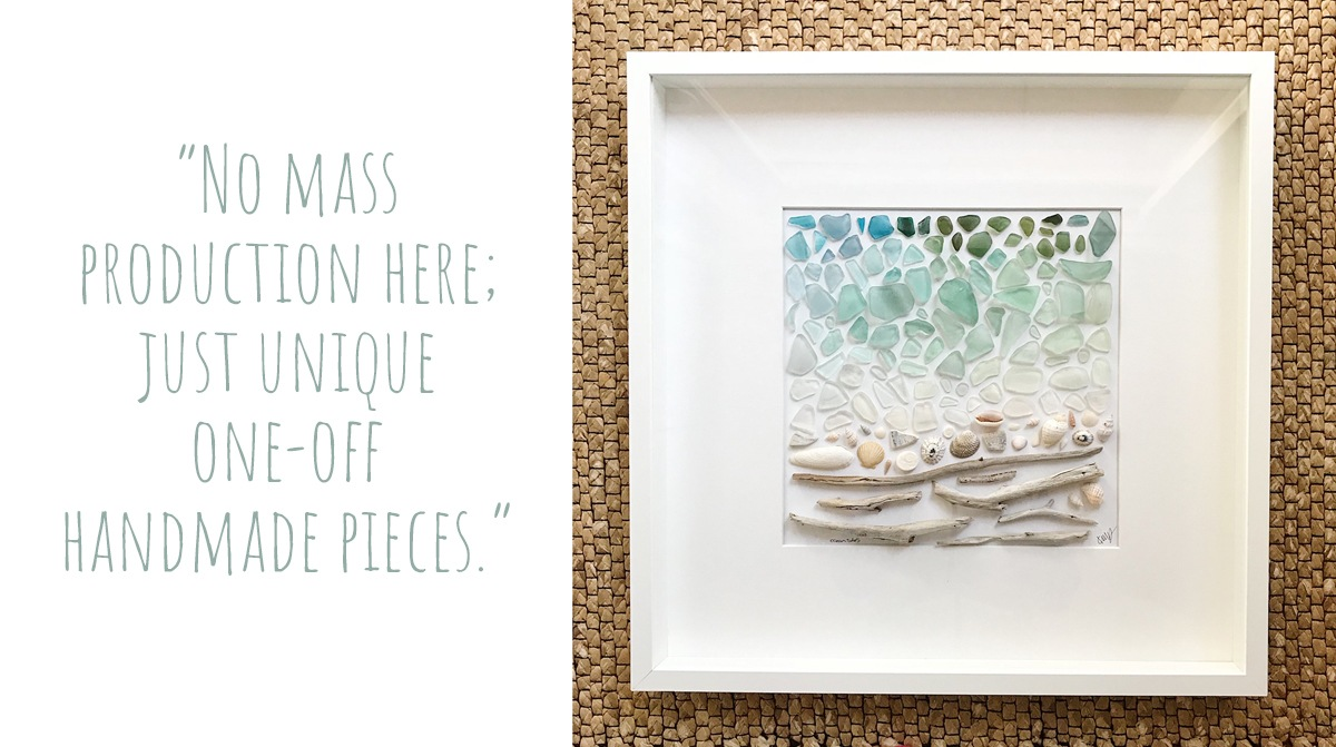 A collage art piece by OMG SeaGlass Designs depicting a coastal scene using drift wood, shells, and sea glass in a gradient of greens, blues, and whites: 'No mass production here; just unique one-off handmade pieces.'