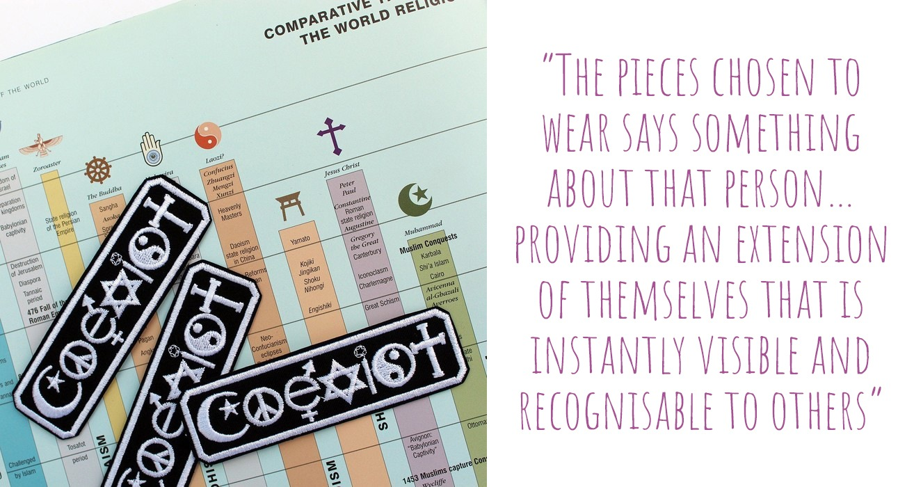 Three 'Coexist' embroidered iron-on badges set against a chart of the world's religions; 'The pieces chosen to wear says something about that person…providing an extension of themselves that is instantly visible and recognisable to others'