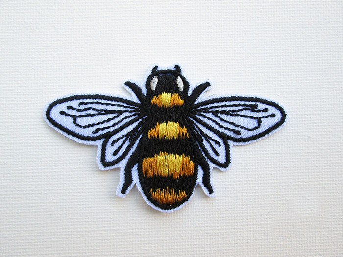 Embroidered black and gold bee iron-on patch, made in Australia by Jan, of PatchHaven