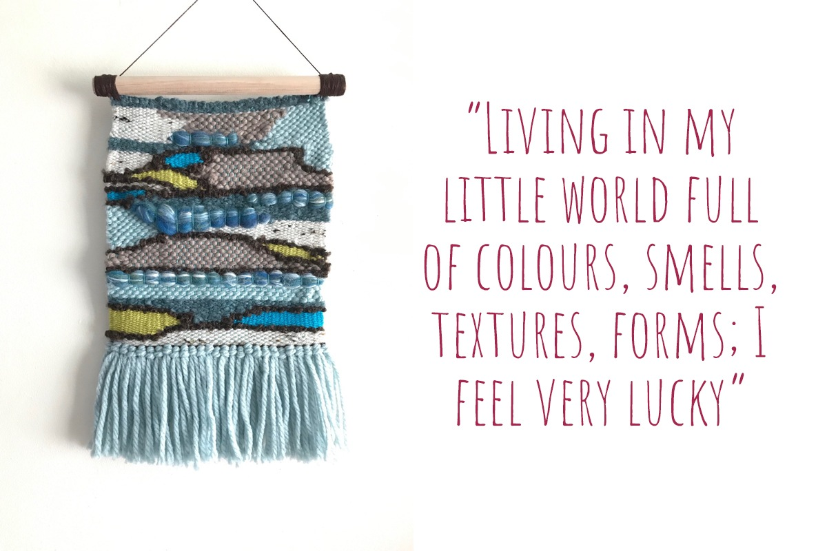 Woven wall hanging in shades of blue and pops of lime green; 'Living in my little world full of colours, smells, textures, forms; I feel very lucky'