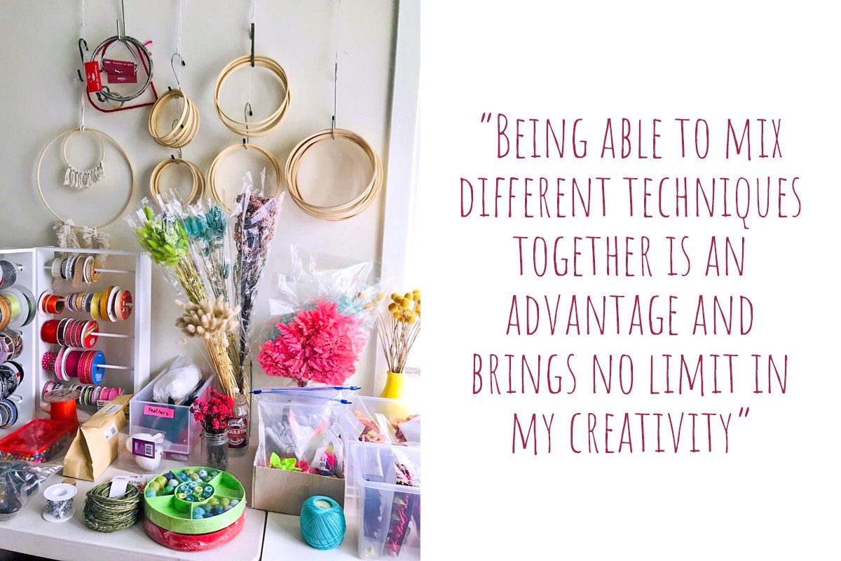 A cluttered desk of colourful craft supplies from ribbons and twines to beads and dried flowers: 'Being able to mix different techniques together is an advantage and brings no limit in my creativity'