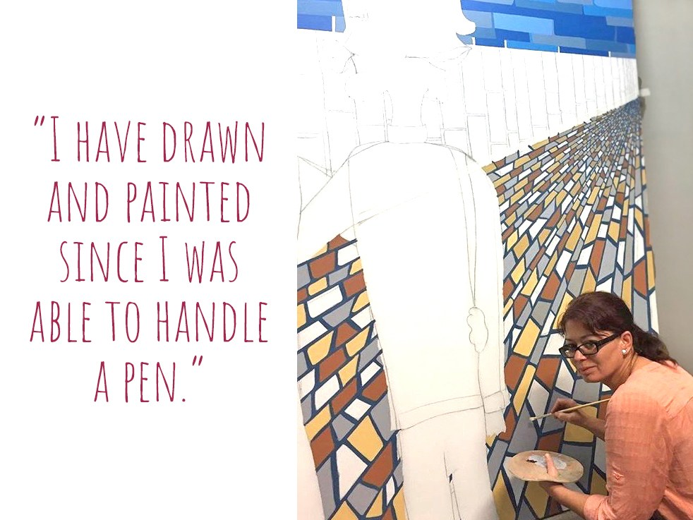 Cristelle at work on a large mural: 'I have drawn and painted since I was able to handle a pen'