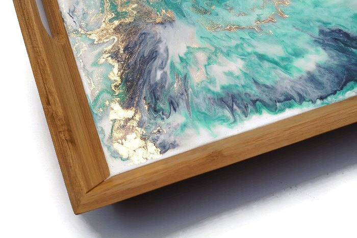 Close up of a teal, blue and white resin-based timber serving tray with veins of sparkling gold by Resin8 Australia