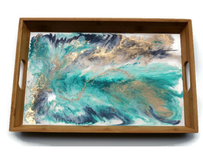 Teal, blue and white resin-based timber serving tray with veins of sparkling gold by Resin8 Australia