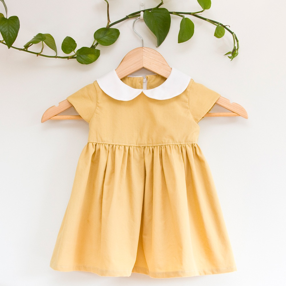 Mustard yellow toddler dress with crisp white peter pan collar, upcycled from a discarded Men's shirt