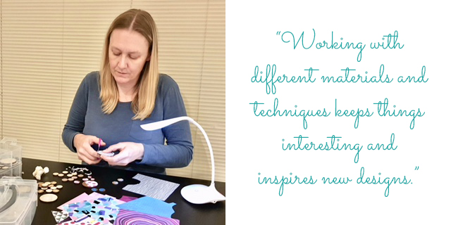 "Natalie at work with several designs: ""Working with different materials and techniques keeps things interesting and inspires new designs."""