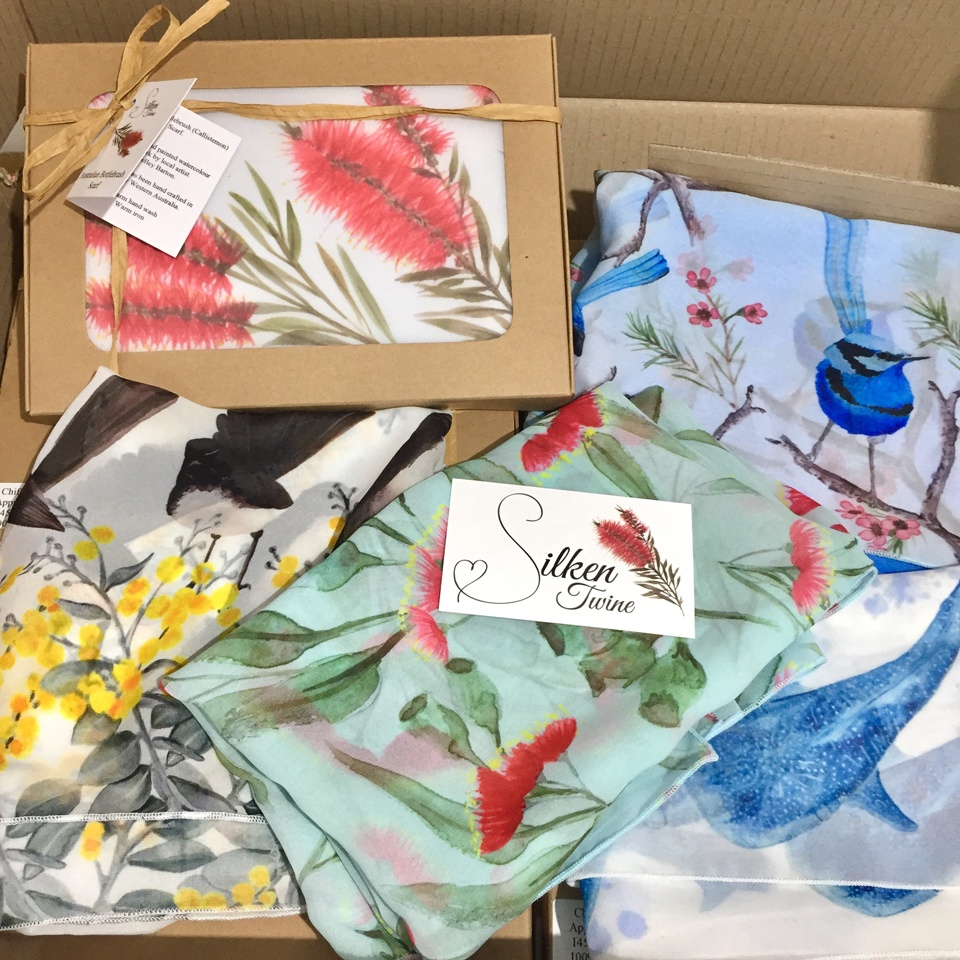 A range of Silken Twine scarves born from Shelley's original water colour paintings of Australian birds, flowers and sea-life'