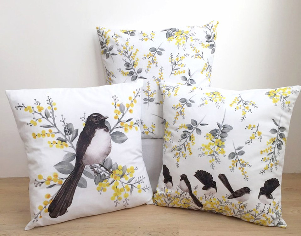Three different Silken Twine handmade cushion covers featuring watercolour Australian wattle and willie wagtail motifs
