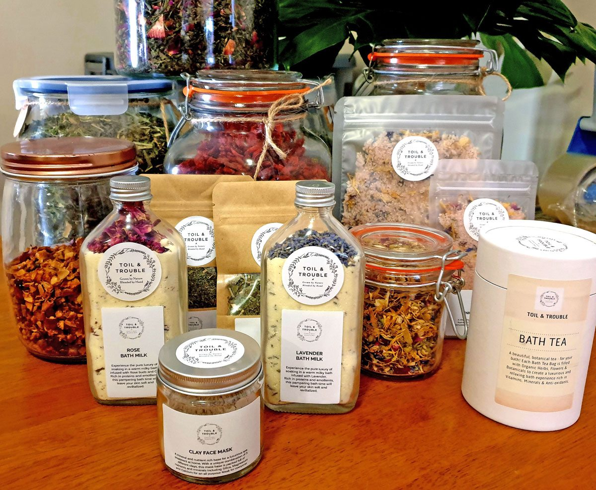 A collection of the Toil & Trouble herbal tea blends and natural body products