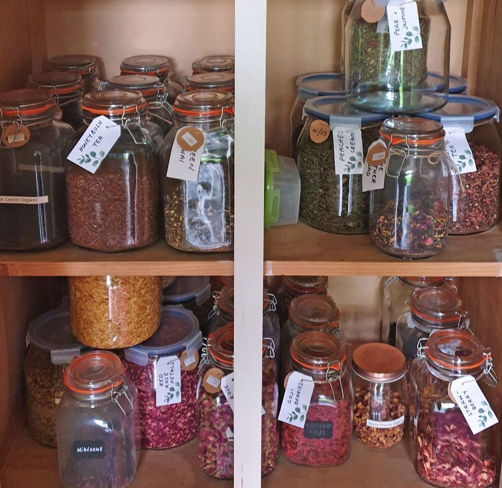 The Toil & Trouble pantry stacked with labelled glass jars of herbal ingredients waiting to be blended