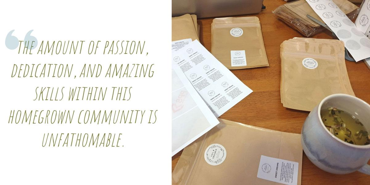 The Toil & Trouble workbench covered in packaging and product labels, and of course, a big mug of herbal tea; 'The amount of passion, dedication, and amazing skills within this homegrown community is unfathomable.'