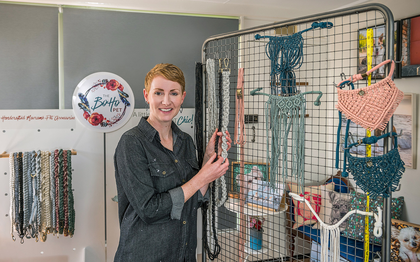 Erin with some of her range of macramé pet accessories and some works in progress