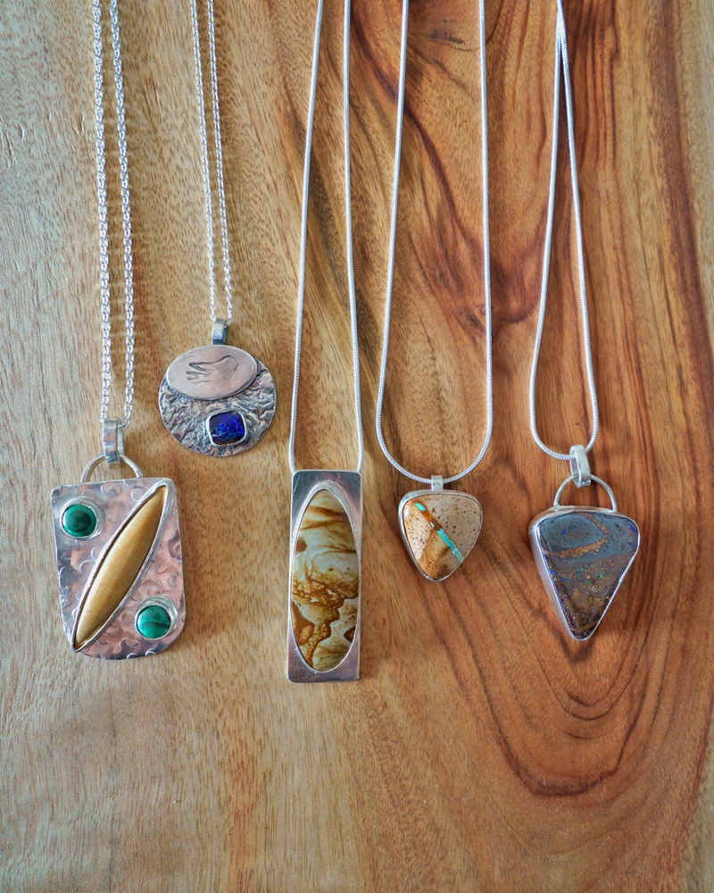 A collection of handcrafted silver and gemstone pendant necklaces by Treasures by Saffron