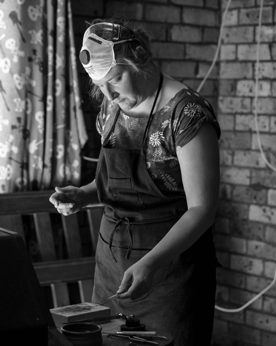 Saffron at work in her garage workshop