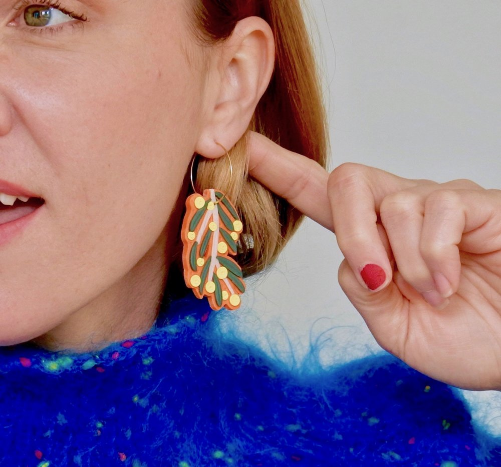 The Hunters True designer and maker, Jess, wearing one of her 'Silver Princess Botanical Hoop' earrings