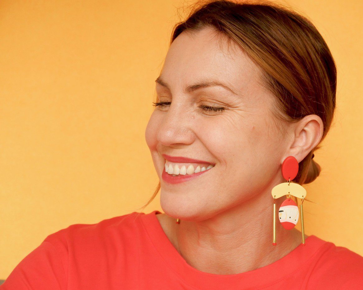 Jess sporting a pair of her vibrantly coloured 'Witchety Way' large statement dangle earrings