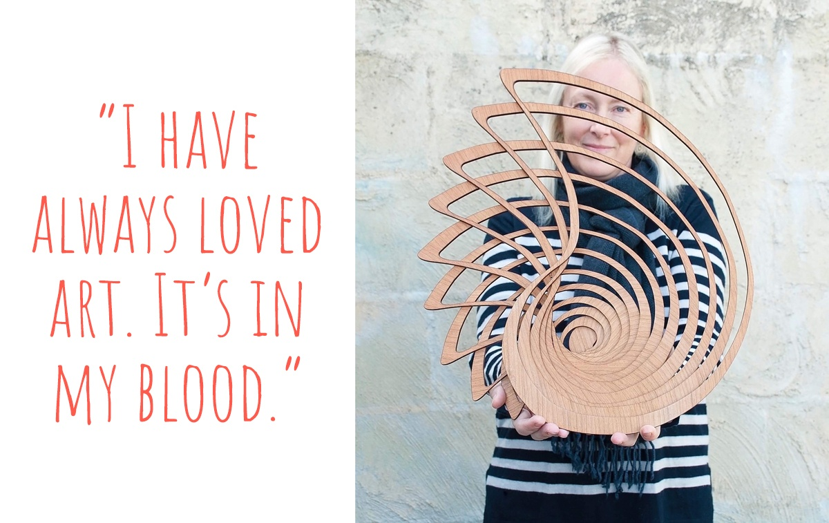 Sue holding one of her large lasercut timber Nautilus bowls; 'I have always loved art. It's in my blood.'
