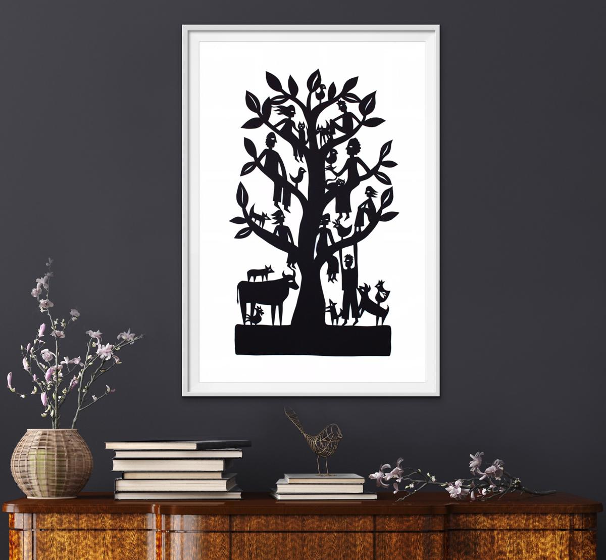 A framed black family tree papercut featuring lots of farm animals