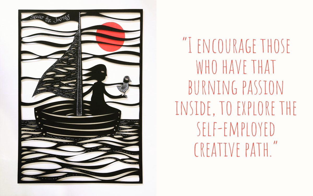 A black lasercut artwork depicting a girl on a boat with a bird in her hand, the words Savour the Journey on the sail of the boat; 'I encourage those who have that burning passion inside, to explore the self-employed creative path'