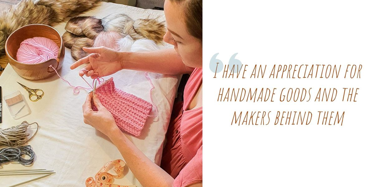 Victoria at work on a pink knitted creation at her dining table: 'I have an appreciation for handmade goods and the makers behind them'