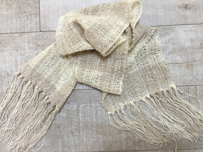 A Tall Tree Weaves open weave acrylic scarf in neutral tones