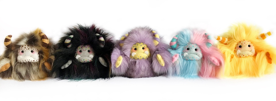 A lineup of unusual suspects: Fluffy 'yeti' handmade art dolls in various colours by Wishsong Design
