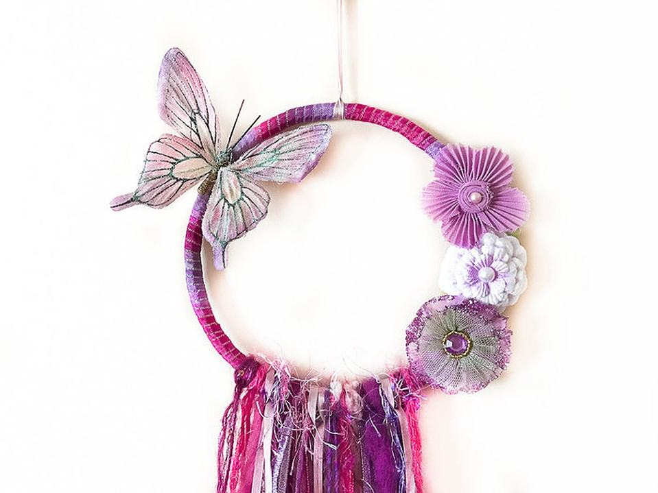 Pretty pink dream catcher with butterfly detail, handmade by Wishsong Design